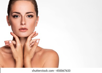 Beauty Portrait. Beautiful Spa Woman. Perfect Fresh Skin. Youth and Skin Care Concept. Studio shot. Isolated on white background