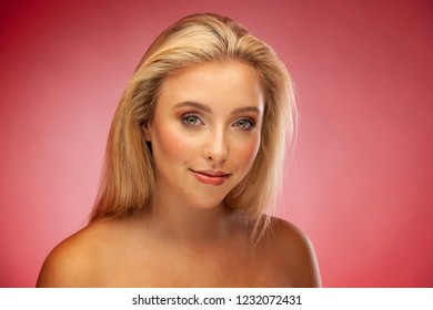 Beauty portrait of a beautiful young blond woman with green eyes