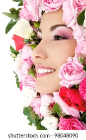 beauty portrait of beautiful young female face with flower roses frame