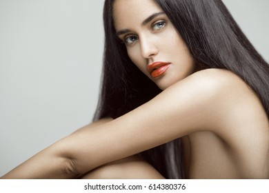 Beauty portrait of beautiful young model girl with long straight hair. Professional makeup.