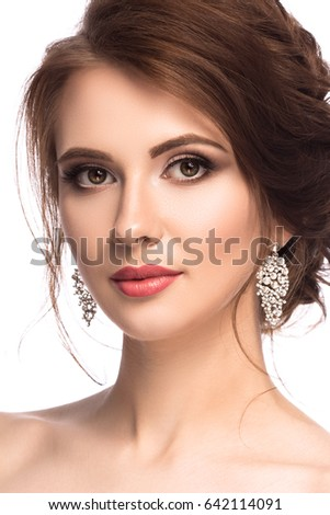 fb57818598af Beauty portrait. Beautiful young woman with perfect makeup and hairstyle  isolated on white background. Glamour look with crystal earrings.