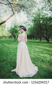 Beauty portrait of bride wearing fashion wedding dress with with luxury make-up and hairstyle.