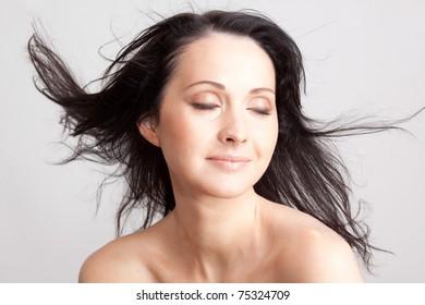 Beauty portrait of brunette woman. Without retouch.