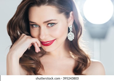 Beauty portrait of a charming woman looking at camera