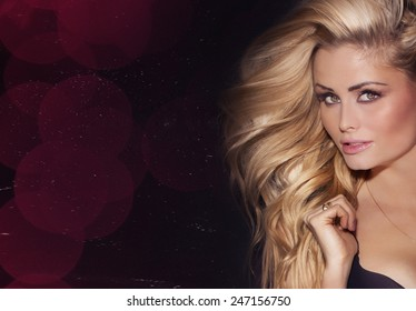 Beauty portrait of delicate blonde woman with long  hair. Girl looking at camera.