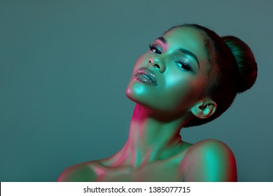 Beauty portrait fashion girl with color lighting filters. Beauty girl face close up. Closeup Sexy woman with copy space. neon light blue and pink color. - image