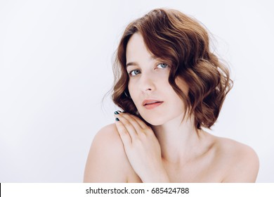 Beauty portrait of female with curly hair and natural skin.