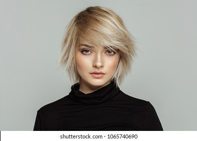 Beauty portrait of female face with natural skin and messed hair