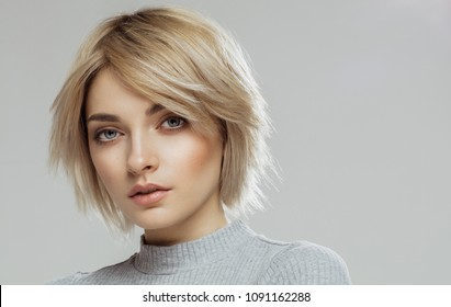 Beauty portrait of female face with natural skin isolated on grey