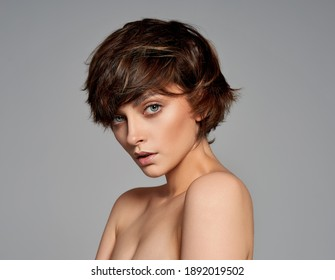 Beauty portrait of female face with natural skin and stylish short hair