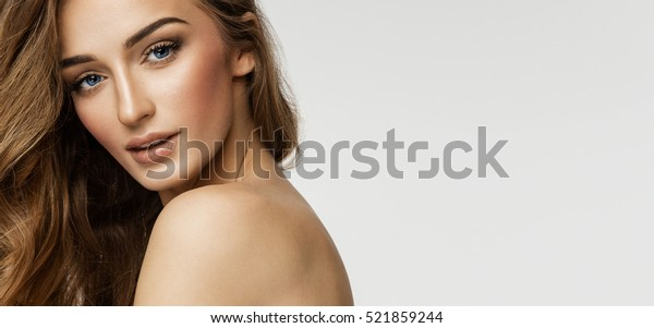 Beauty portrait of female face with natural skin