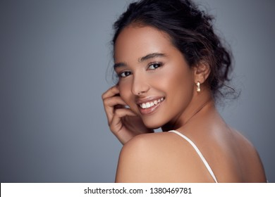 beauty portrait of female laughing from her shoulder