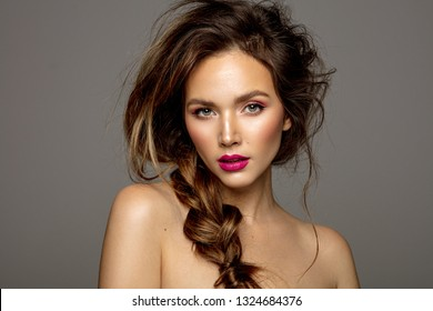 Beauty portrait of female model with messy hair and braid