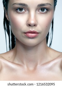 Beauty portrait of female  with shiny glitter skin. Woman with natural beauty makeup.