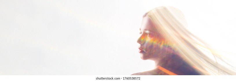 Beauty portrait. Femininity elegance. Woman with long hair in bokeh light rays double exposition isolated on white.