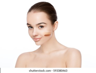 Beauty portrait with foundation stripes different tone makeup on white background