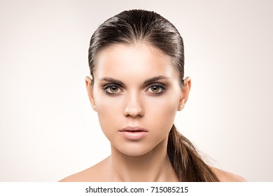 Beauty portrait of girl with perfect nude make-up. Beauty salon. Head, eyes, hair, shoulders, studio, indoors. Perfect skin. Natural makeup. Skin care concept beautiful skin