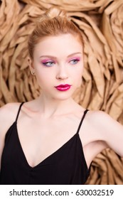 Beauty portrait of girl with pink make up in studio