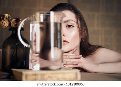 Beauty portrait of girl with water and reflections. Hight quality retouching photo. Fashion model.