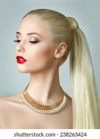 Beauty portrait of gorgeous blonde woman with ponytail