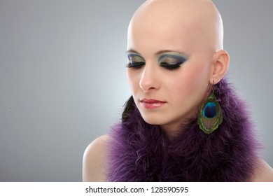 Beauty portrait of hairless woman in purple boa.