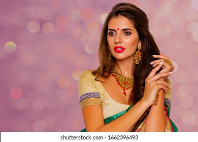 Beauty Portrait indian girl.  Jewelry. Young Hindu woman model with kundan jewelry set. Red lips. Close up. Traditional India costume  lehenga choli or sari. make-up