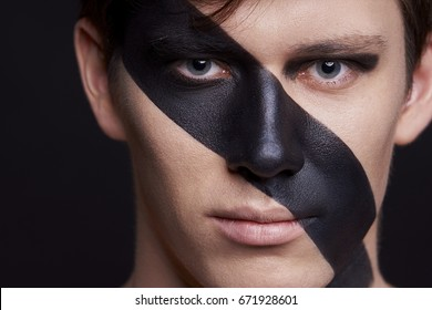 Beauty portrait of man face with black strip