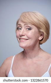 beauty portrait of mature caucasian woman blond happy cheerful smiling face skin teeth