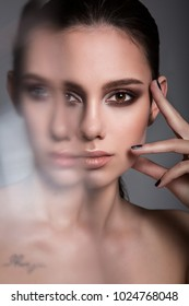 Beauty portrait of model with make-up. Fashion shiny highlighter on skin, sexy gloss lips make-up