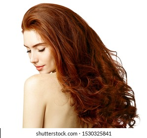 Beauty portrait of redhead woman with beautiful long wavy hair. Over white background.