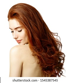 Beauty portrait of redhead woman with perfect skin. Over white background.