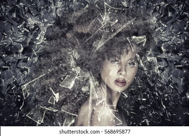Beauty portrait of sensual african american woman with long curly hair , looking through broken glass.