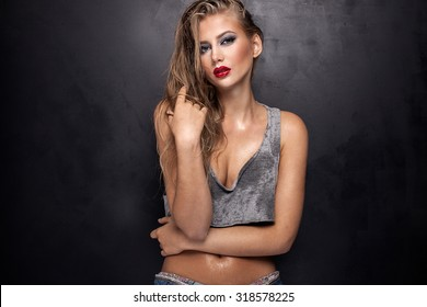 Beauty portrait of sexy young woman with glamour makeup. Girl looking at camera. Studio shot. Closeup photo.