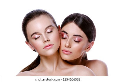 beauty portrait of two attractive caucasian young women brunette isolated on white studio shot face skin makeup cosmetics eyes closed lips beautiful natural fresh