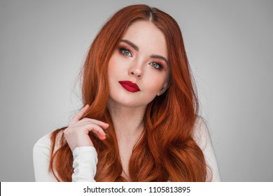 Beauty portrait of woman. Gorgeous sensual attractive pretty redhead sexy model girl, shiny wavy hair.