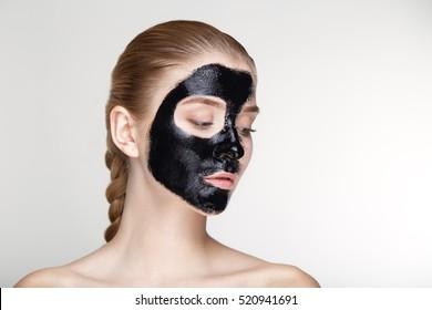 Beauty portrait woman skin care health black mask white background close up