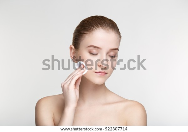 Beauty portrait woman skin care health black mask white background close up Sponge tips