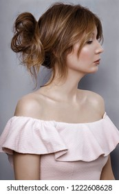 Beauty portrait of young adult woman dressed pale-pink dress with flounces.