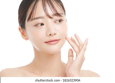 Beauty portrait of young Asian woman on white background