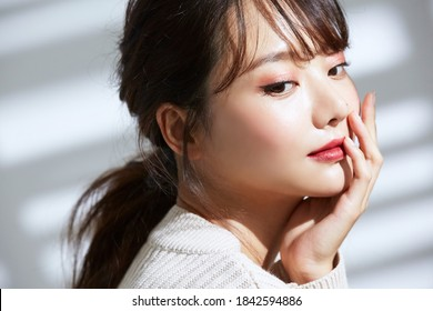 Beauty portrait of young Asian women on light and shadow background