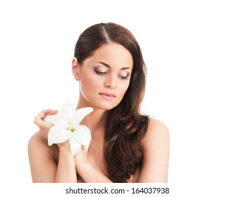 Beauty portrait of young, attractive, fresh, healthy and natural woman with the lily flower isolated on white
