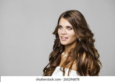 Beauty portrait of young attractive woman, isolated on gray