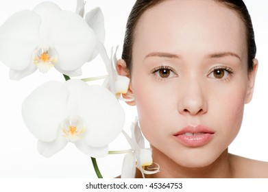 beauty portrait of a young and attractive woman isolated on white background with flowers