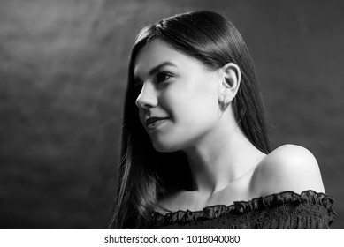 Beauty portrait of a young beautiful brunette girl with long black straight flying hair. Magnificent hair. Black and white