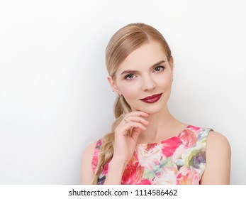 Beauty portrait of young beautiful cheerful young fresh looking woman with bright trendy make up blond healthy hair braid hairstyle.