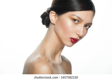 Beauty portrait of young beautiful ethnic woman with fashion makeup. Portrait of mixed race Asian Caucasian girl  isolated on white background