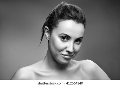 Beauty portrait of young caucasian brunette woman. Smiling and perfect skin. Natural nude makeup. Black and white