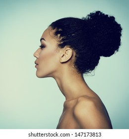 Beauty portrait of young fresh fashion woman in profile, toned
