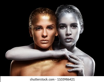 Beauty portrait of young gorgeous women. Golden and silver girls on black background.