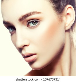 Beauty portrait of young woman with beautiful healthy face skin, studio shot of attractive girl with natural makeup, toned